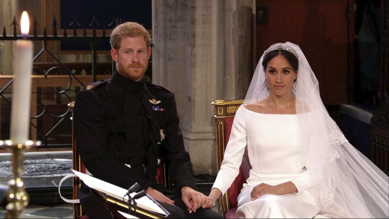 Harry y Meghan escuchan uno de los sermones durante la ceremonia religiosa. (Foto: AP)