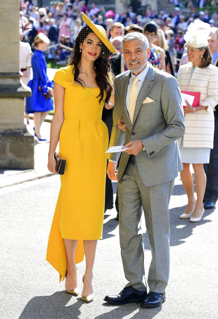 Amal y George Clooney, entre los invitados a la boda de Meghan y Harry. Ella fue una de las invitadas mejor vestida con una pieza de Stella McCartney.  (Foto: AP)