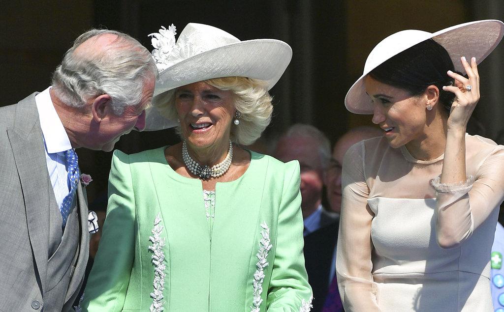 El príncipe Charles también estuvo atento a su flamante nuera y conversó simpáticamente con Meghan. (Foto: AP)