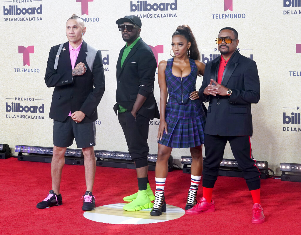 will.i.am, J. Rey Soul y apl.de.ap de Black Eyed Peas. (AP)