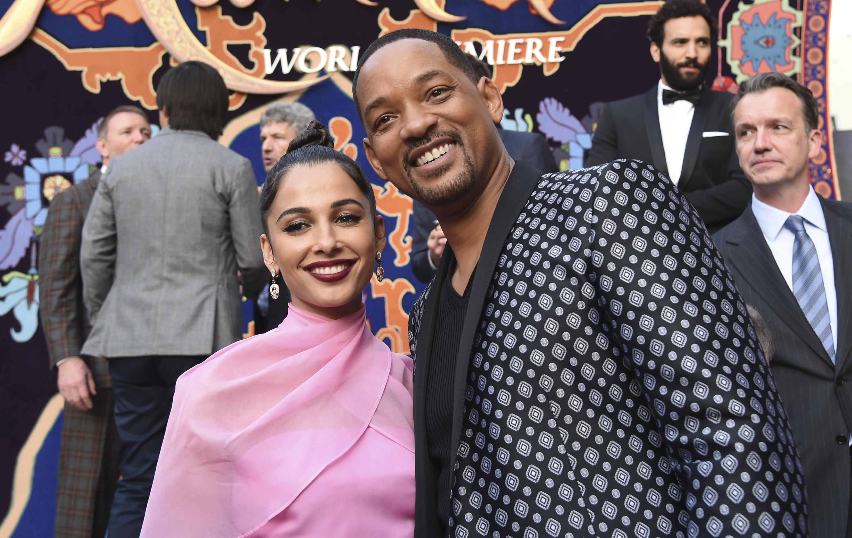La princesa Jasmine de carne y hueso, Naomi Scott, y Will Smith. (Photo by Chris Pizzello/Invision/AP)