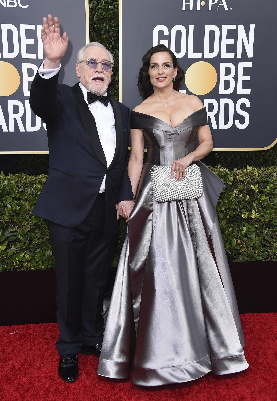 """Ganador de un Golden GLobe por su interpretación de Logan Roy en """"Succession"""", Brian Cox y su esposa Nicole Ansari-Cox. (AP)"""