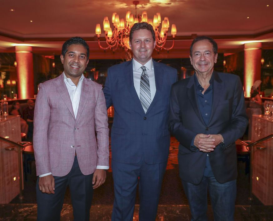 Fahad Ghaffar, Ben Tutt y John Paulson. Foto suministrada