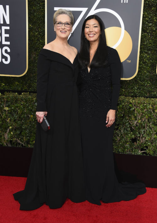 Meryl Streep y Ai-jen Poo. (Photo by Jordan Strauss/Invision/AP)