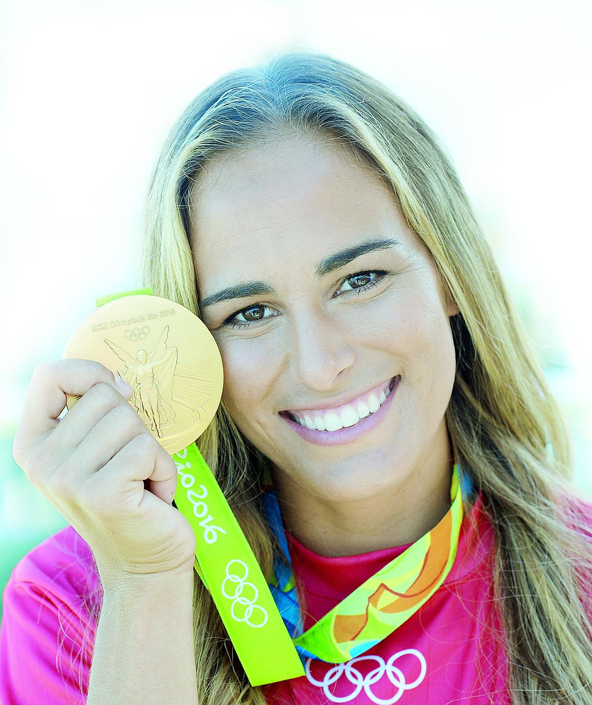 Mónica Puig (nacida en 1993): Primera en ganar una medalla de oro por Puerto Rico en las Olimpiadas. (Archivo)