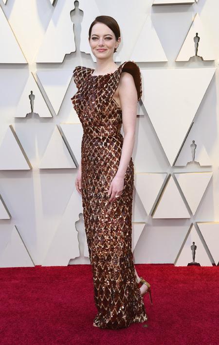 Emma Stone con un vestido Louis Vuitton. (AP)