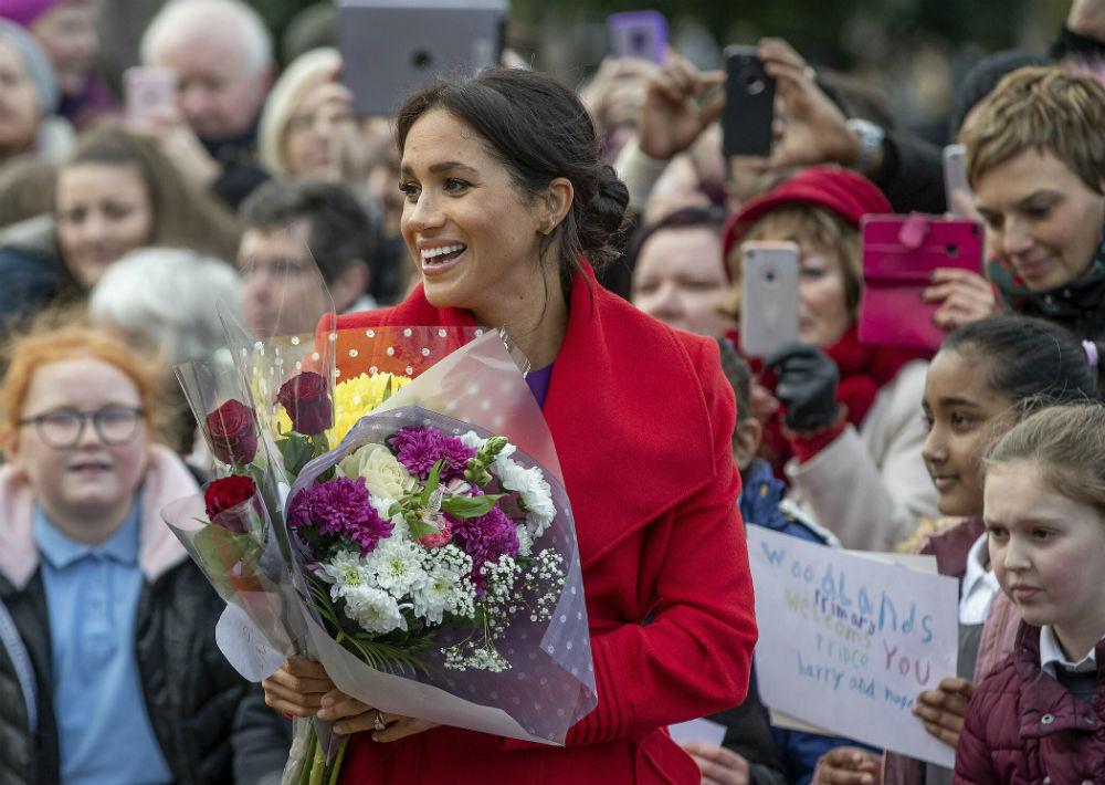Durante la visita, la duquesa de Sussex, Meghan Markle lució su cada vez más avanzado embarazo. (AP)