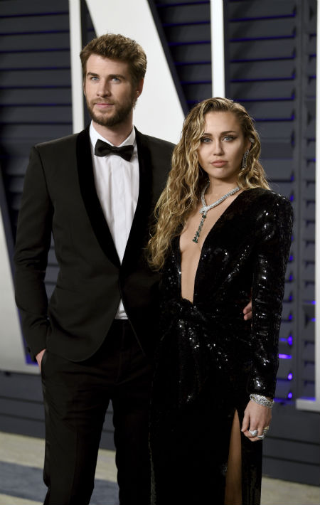 Liam Hemsworth y Miley Cyrus. (Evan Agostini/Invision/AP)