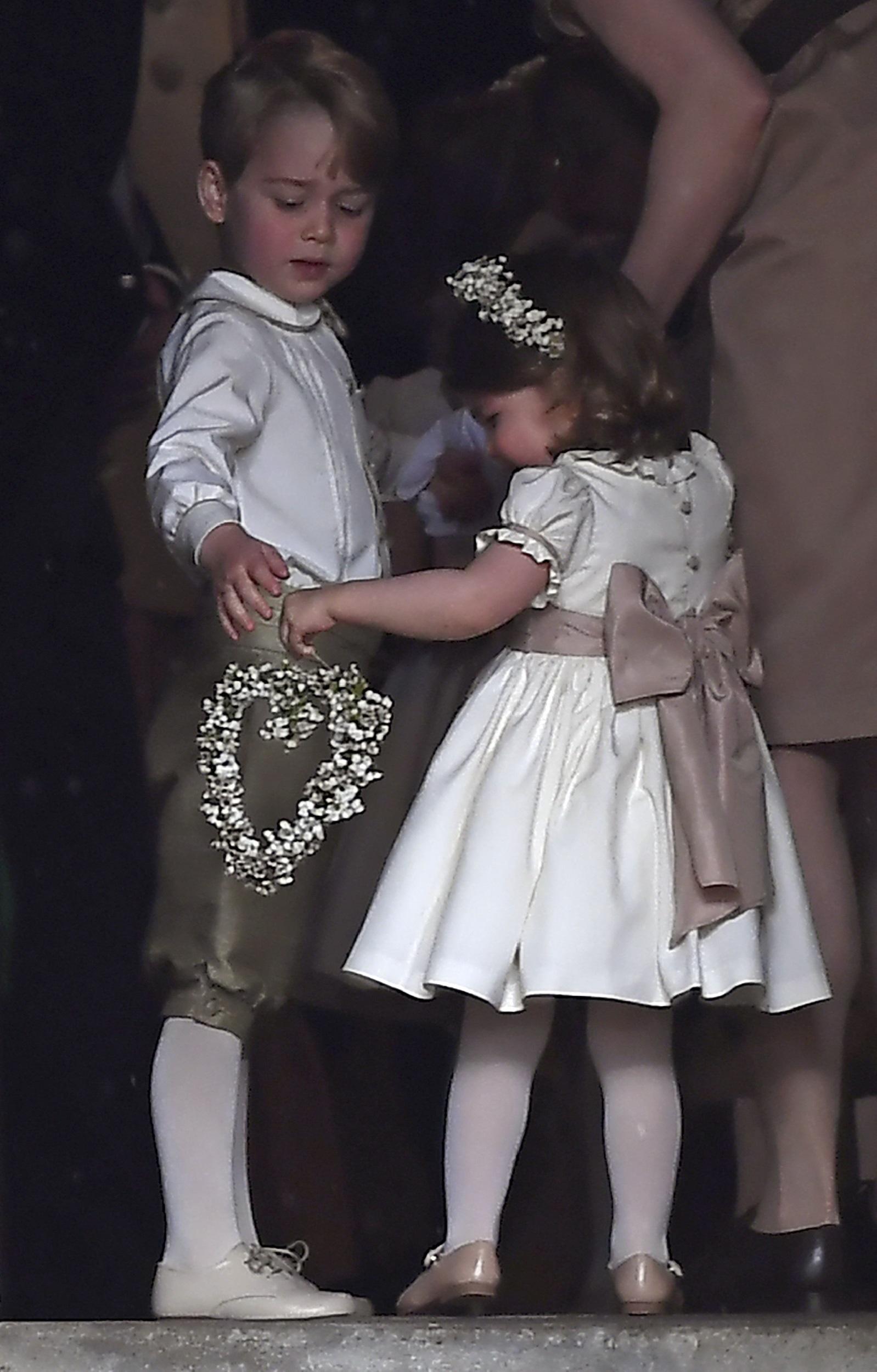 Los hijos de la duquesa de Cambridge y el príncipe Guillermo, Carlota y Jorge. (Justin Tallis/Pool via AP)
