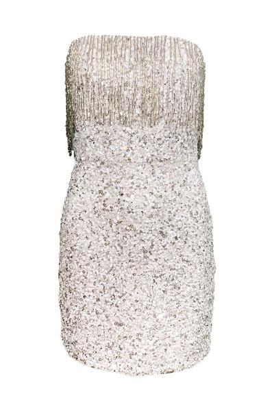 "Vestido blanco ""strapless"" con detalle de lentejuela y detalles de flecos plateados de Olivia Boutique. (Suministrada)"