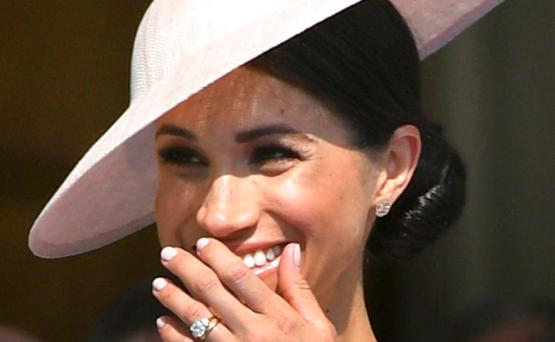 Meghan luce risueña y feliz en su primera aparición oficial tras la boda